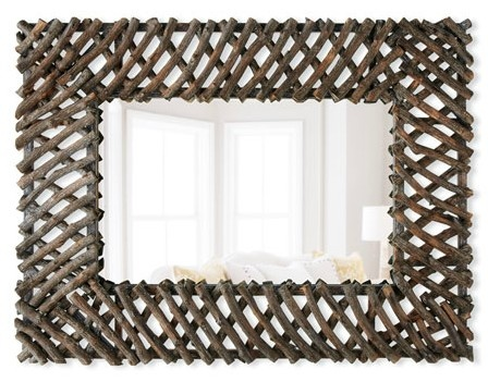 Grab a simple frameless mirror from IKEA or a home improvement store, gather sticks while doing routine yard cleanup, spray paint them (or leave au naturel) and put that hot glue gun to work.