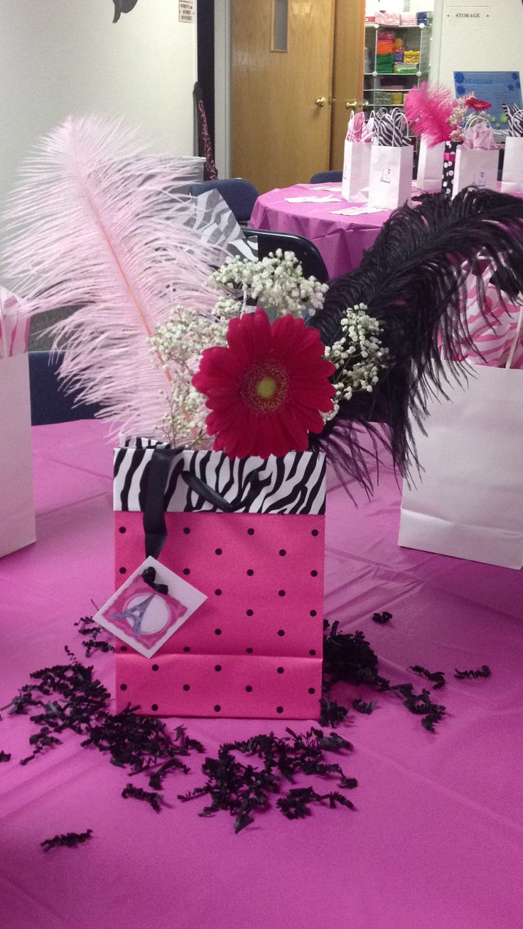 Fun easy centerpiece using a gift bag feathers