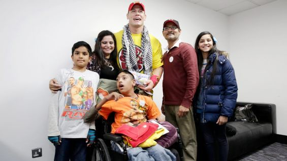 The Cenation leader poses with Rahim's family. #WWE
