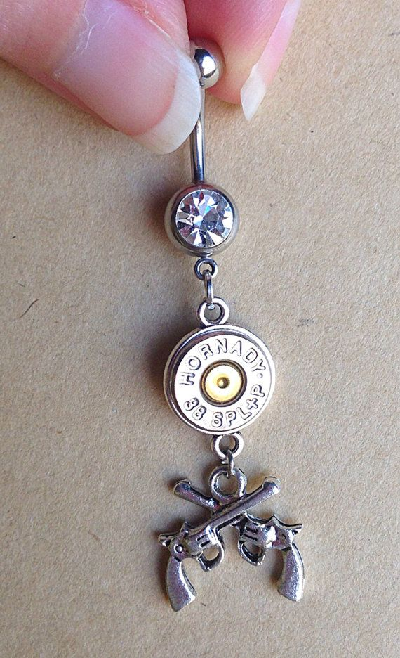 Bullet jewelry. Belly button ring with guns and bullet casing on Etsy, $10.99