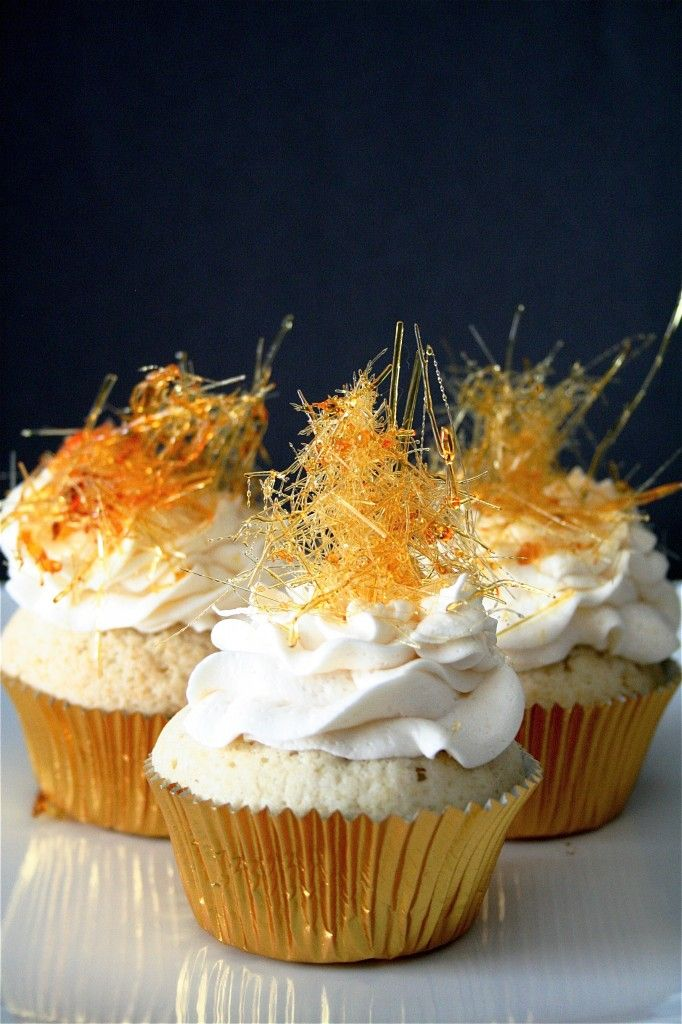 // Champagne Cupcakes with Champagne Buttercream topped with spun sugar. Perfect for New Year's.