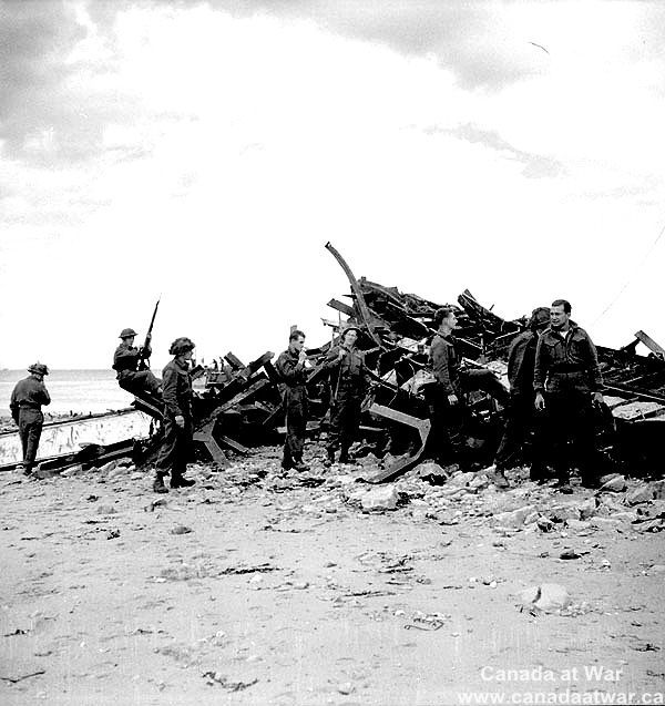 D-Day, Juno Beach - Highland Light Infantry of Canada examine wreck of Landing Ship, Infantry (L.S.I.) in which they came ashore during