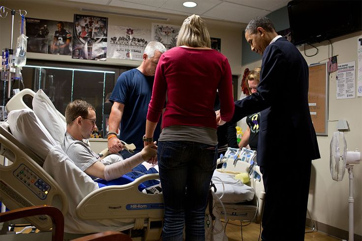 """The President prays with a wounded service member and his family during a visit to Walter Reed National Military Medical Center in Bethesda, Md. The President likes to make a few trips a year to Walter Reed to visit wounded warriors and their families."" (Official White House Photo by Pete Souza)"