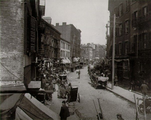The first American slum: Mulberry Bend, photo by Jacob Riis, c. 1888.  In 1880 there were 37,000 tenements housing nearly 1.1 million people. Most were one or two room apartments. There was no running water & the bedrooms often had no windows at all. It was demolished to be turned into Columbus Park in 1896.