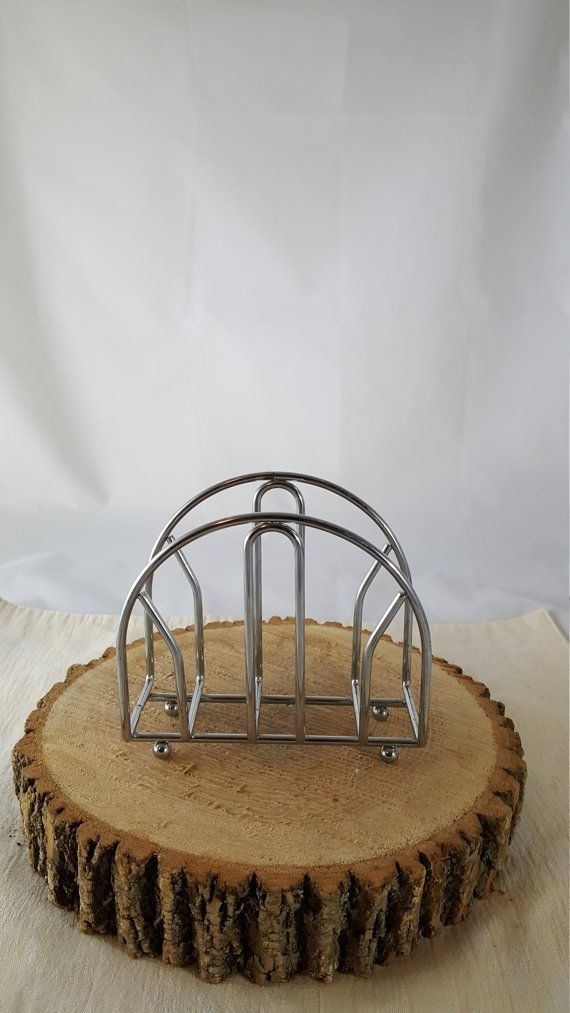 This is a great industrial look or restaurant looking napkin holder. The frame stands on 4 round stainless steel balls with a 2 1/2 width to hold many paper or cloth napkins. Add this to your counter top and use on the table. Comes in handy at party time and keeps the napkins organized. 5 high 5 1/4 long 2 1/2 wide  Check my items if you like this look. I have other table decor in stainless steel.