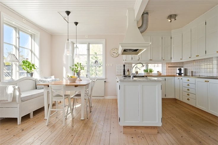 Nice Swedish Kitchen,  Like the cabinets not the furniture.
