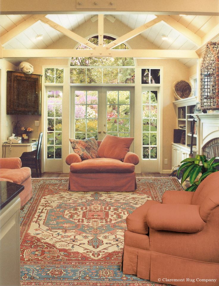 Antique Persian Rug Graces This Charming Sunroom With A