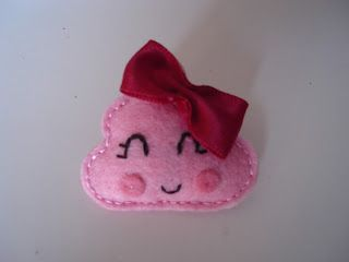 little pink brooch thing