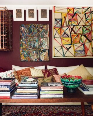 A bright Allen Maddox painting (right) dominates the Carringtons' favourite room, created from the old Public Trust safe; the wall-mounted French steel cage, which holds wine, came from Greytown.