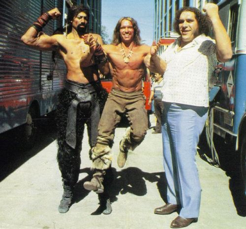Wilt Chamberlain, Arnold Schwarzenegger and Andre the Giant.  I'm guessing this is the set of Conan the Barbarian.