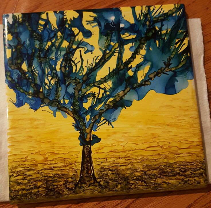 Alcohol Ink Bathroom Tile - Wiped on yellow background with alcohol ink felt stamp, dripped blue ink and used canned air to create pattern, painted tree trunk and foreground, sealed with auto paint clear enamel