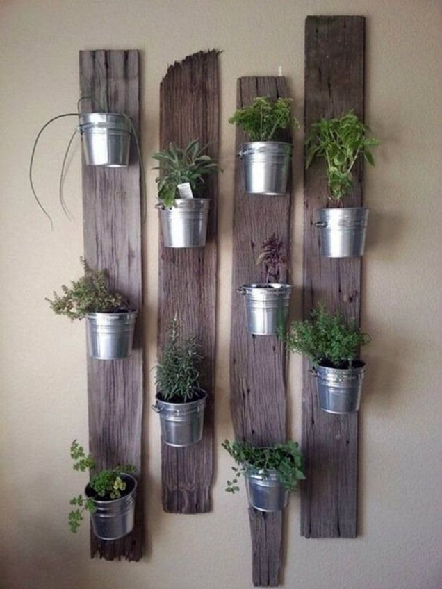 Vertical Gardens indoor herb garden idea: Tin Buckets on Re-Purposed Wood - In this post, we'll share 9 beautiful ways to bring your herb garden indoors, so that you can enjoy fresh herbs all year long. Vertical Garden Planters, Vertical Gardens, Planter Pots, Balcony Garden, Planter Ideas, Planter Garden, Wall Herb Garden Indoor, Small Gardens, Diy Wall Planter