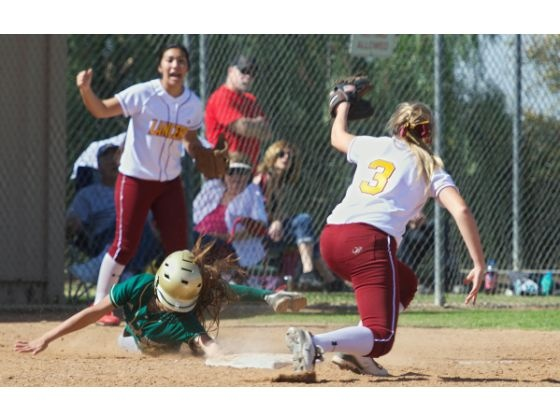 Chayan Rivera (#21) of Brea Olinda is tagged out at third by Molly Bourne (#3) of La Serna of Whittier in a pool play game of the Brea Olinda High School Softball Tournament on Saturday. La Serna beats Brea Olinda, 12-5.
