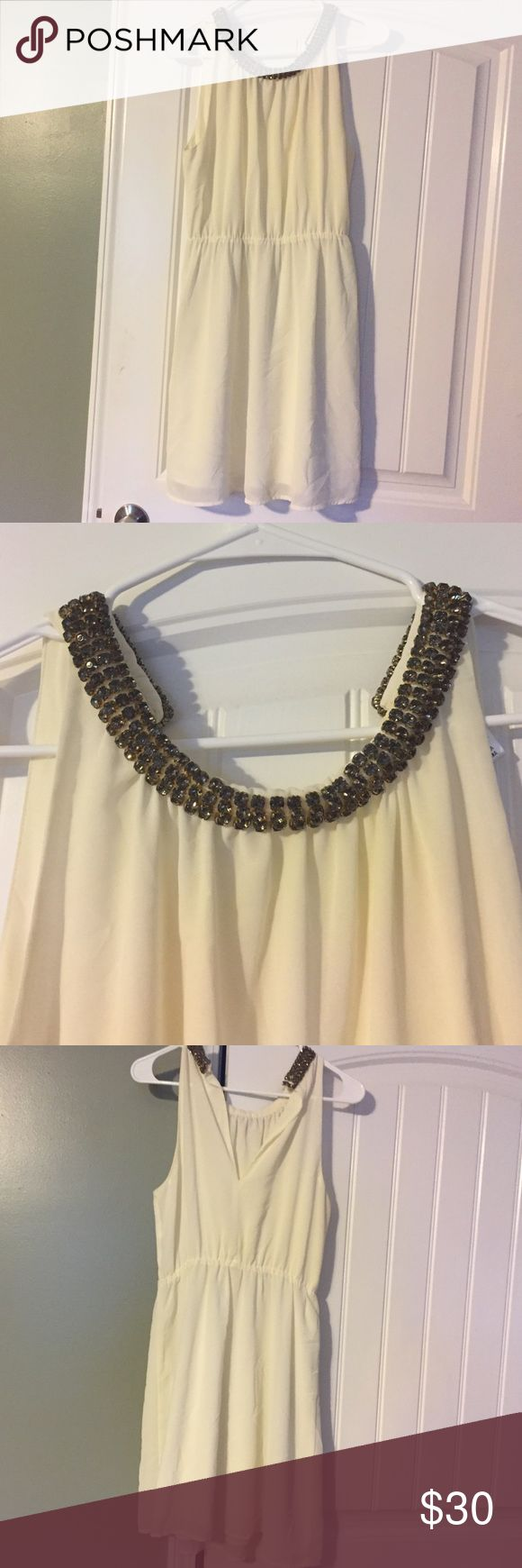 Elegant White Cocktail dress with gems! Worn once! Adorable on!....* These items are put up and not worn after pictures are taken Please note, I do my best to inspect and go into detail to my best ability on each item, please ask any and all questions before purchasing* I really want everyone to be satisfied and ❤️ their items! Esley Dresses