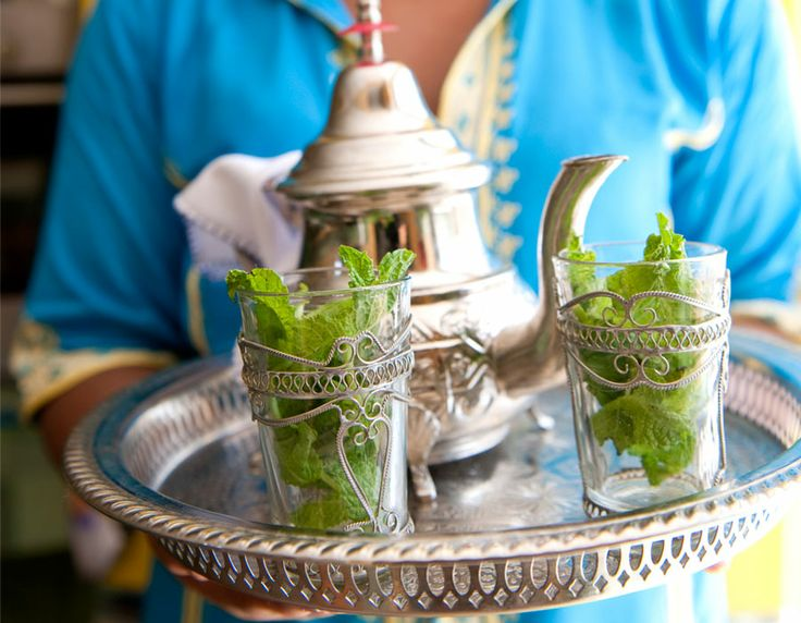 Welcome to Morocco! Moroccan mint tea served in a traditional teapot and tray. #Moroccan #Hospitality #MintTea.
