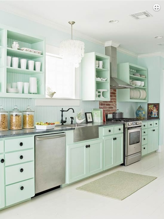 aqua, mint, light green kitchen cabinets with white floor and stainless appliances.
