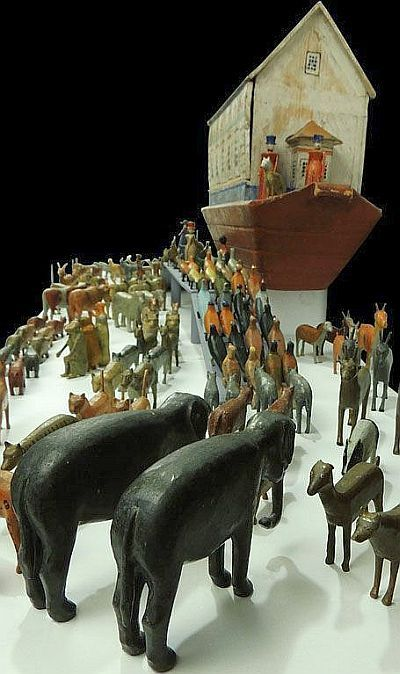 Carved wooden animals queuing up to enter the ark