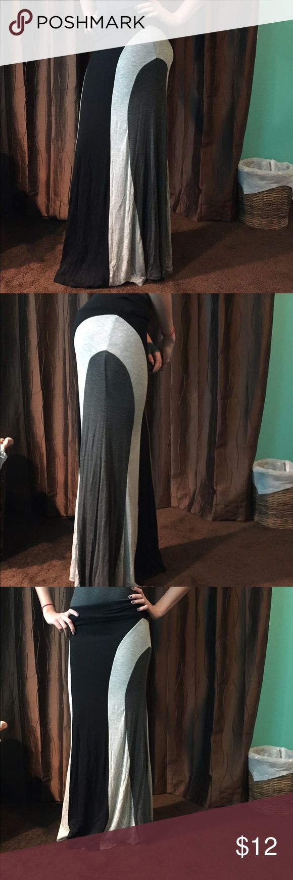 """Black and grey maxi skirt Very form fitting and flattering maxi skirt. It is size small but fits this 5'10"""" model fine. It is very soft material. The elastic in the waistband was sewn in and it's not very smooth, but it doesn't affect the fit at all Monteau Skirts Maxi"""