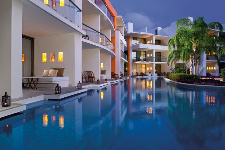 Our swim-up suites at Secrets Aura Cozumel allow guests to enjoy the swimming pools with direct access from their private terrace.