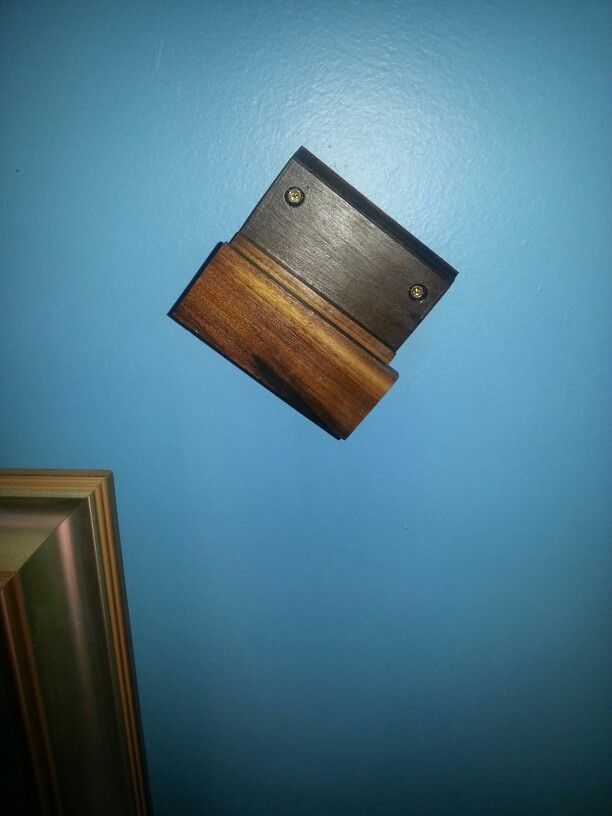 Hand made bracket to mount my field hockey stick on my wall