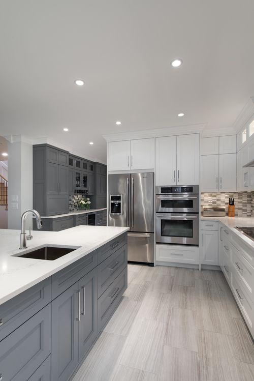 Modern White & Gray Kitchen - Bright, modern, gray, white, kitchen, gray cabinets, white cabinets, white countertop, stone flooring - Interior design of a home in Richmond, BC by AK Interiors.