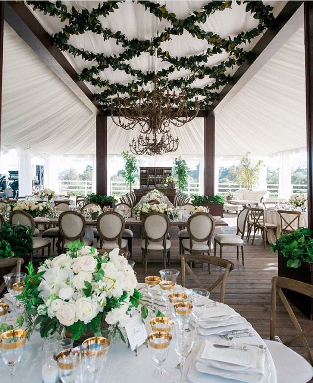 Draped tent + criss-cross overhead floral garland by Revelry Event Design and Mindy Rice Design.