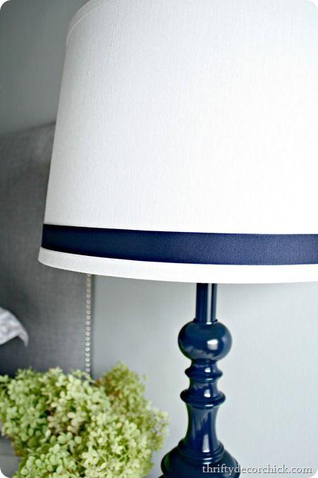 ribbon on lamp shade. base spray painted navy blue in gloss (krylon). great way to dress up a boring lamp!
