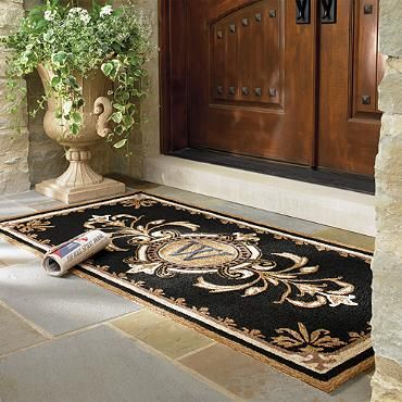 A long black, white and tan monogrammed door mat - perfection! Huntington Monogrammed Entry Mat