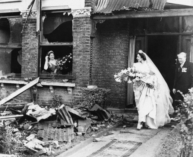 Miss Ena Squire-Brown, an international dancer (famed for her Dove Dance) leaving her recently bombed London home for St. George's Church in Forest Hill, to marry Royal Air Force flying officer J.C. Martin in 1940
