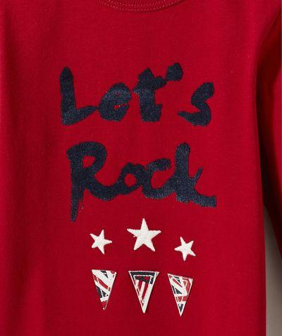 LE TEE-SHIRT GEORGES :                     Un tee-shirt à l'esprit rock pour un look moderne cette saison !            LE TEE-SHIRT FLOQUÉ, col rond, manches longues, fermeture épaule par pressions.