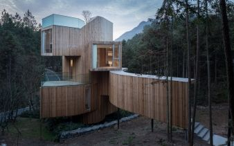 The home is covered in the same red cedar wood found in the surrounding forest
