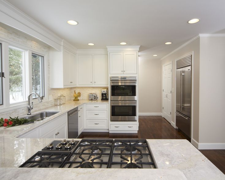 Taj Mahal Quartzite Wtih White Cabinets Light Open