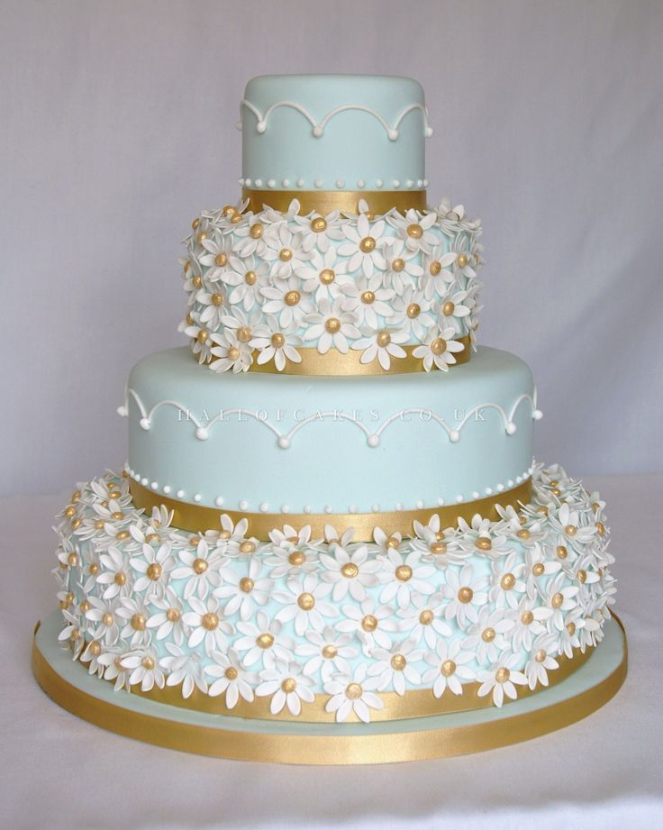 Daisy cake with light blue and gold | Hall of Cakes This is sweet...with silver instead of gold, silver centers in the daisies, white daisies and a shade of blue icing to match the blue, silver, and white winter wonderland theme....B E A U T I F U L !