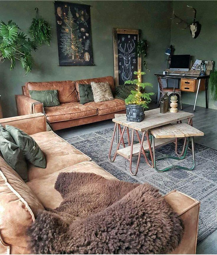 Beautiful warm colours - tan sofas, green walls