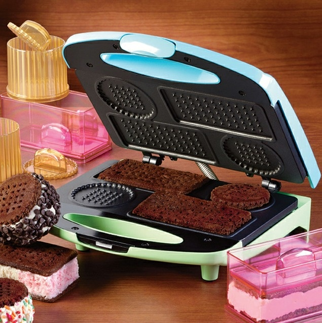Ice Cream Cookie Sandwich Maker... The quick-cooking grill makes perfectly shaped round and rectangular cookies. Translucent ice cream sandwich molds open on both ends and have large, easy-to-grip handles. Enjoy creating different flavors and varieties - you may even use your Ice Cream Sandwich Maker grill to cook Italian pizzelles for more dessert options. Retails for $24.00 ... #Cookware #KitchenEquipment #Kitchen #Design #KitchenGadgets