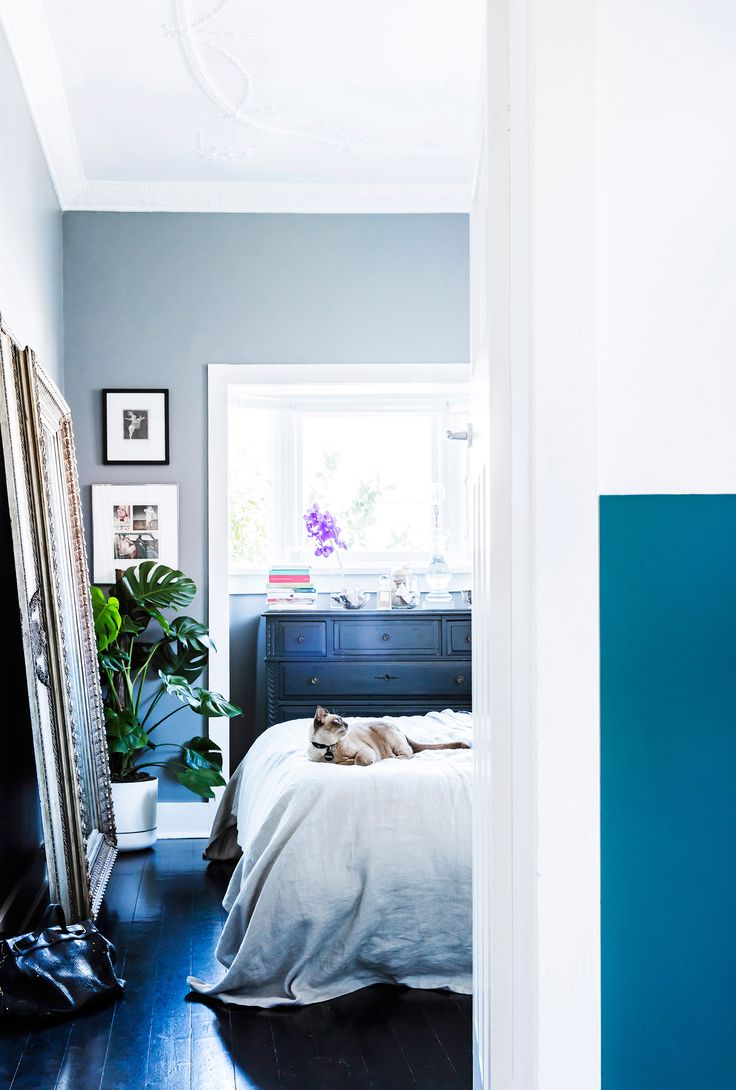 Bedroom in a Bondi home painted in elegant blue-grey hue decorated with a vintage mirror and chest of drawers. Photography: Maree Homer   Styling: Kristen Bookallil   Story: real living
