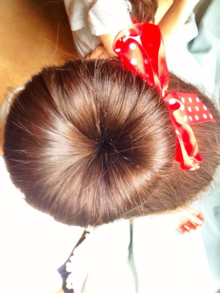 Sock bun with a red bow