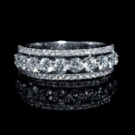 NEW: Three row diamond wedding ring featuring 54 round brilliant cut white…