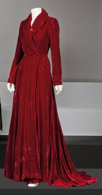 Marcel Rochas circa 1950  Long red velvet coat, shawl collar, double-breasted with two buttons