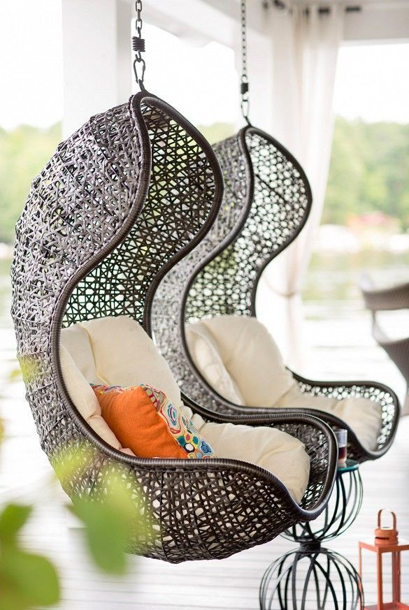 Hanging lounge chairs on a wooden deck: