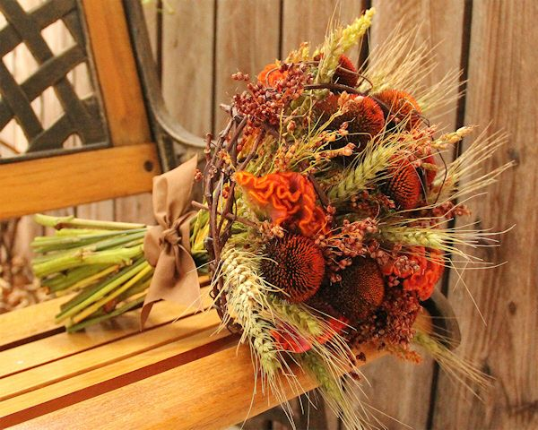 Grapevines twining around wheat and flowers make this Bride's Bouquet perfect for a Fall wedding.