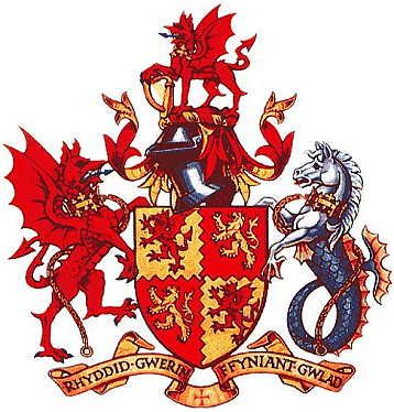 """Carmarthenshire Coat of Arms (Wales): """"The arms combine the traditional arms of the kings of South Wales with the red Welsh dragon. The red dragon appears again as crest and dexter supporter. The sinister supporter is a sea horse suggesting the County's maritime heritage."""" http://www.internetbusinessdirectory.co.uk/arms/carmarthenshire-coat-arms.htm"""