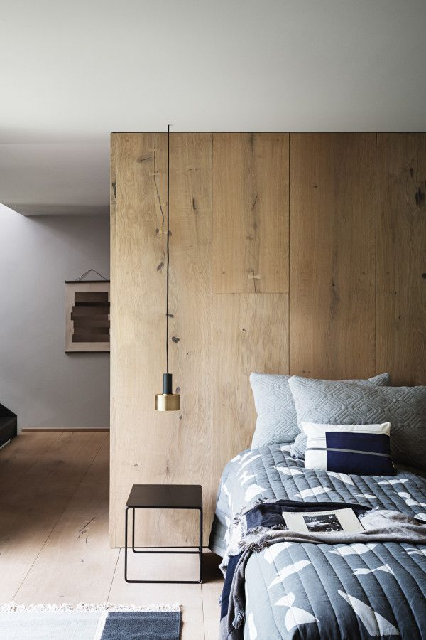 Wide plank wooden wall with natural finish is accented by minimalist pieces and neutral tones.