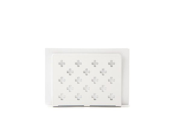 Metal napkin holder. White swiss cross pattern. Stylish and useful, this napkin dispenser will make a lovely unique centrepiece for your table. Other colors available.  ↳ Laser cut metal ↳ 4.8 x 3.6 ↳ 12 x 9cm ↳ Contact us if you would like customise further!  ✈ We choose the best shipping option to get your package to you! ✈ Air delivery from Ukraine by registered mail with tracking & insurance ✈ Please allow 10-15 days for delivery to North America and Japan, Australia ✈ 18 to 25 days ...