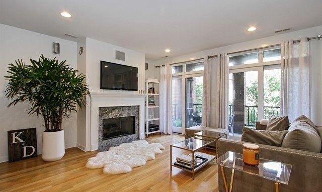 Modern Living Room With Floor To Ceiling Windows White Fur Rug Mosaic Tile Fireplace Hardwood Modern Living Room White Cowhide Rug Floor To Ceiling Windows