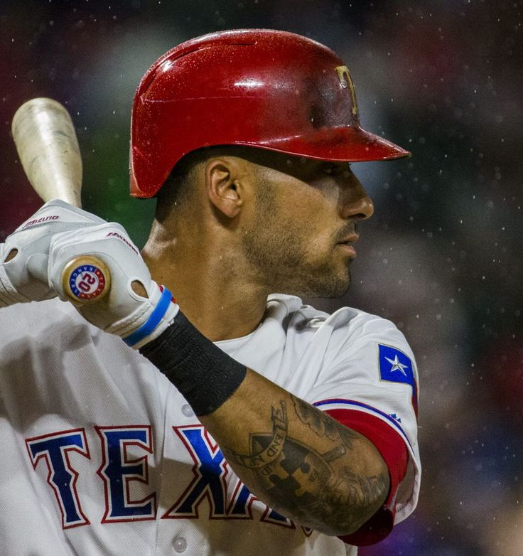 Texas Rangers left fielder Ian Desmond (20) bats in the rain during the eighth inning of their game against the Los Angeles Angels on Monday, May 23, 2016 at Globe Life Park in Arlington, Texas. (Ashley Landis/The Dallas Morning News)