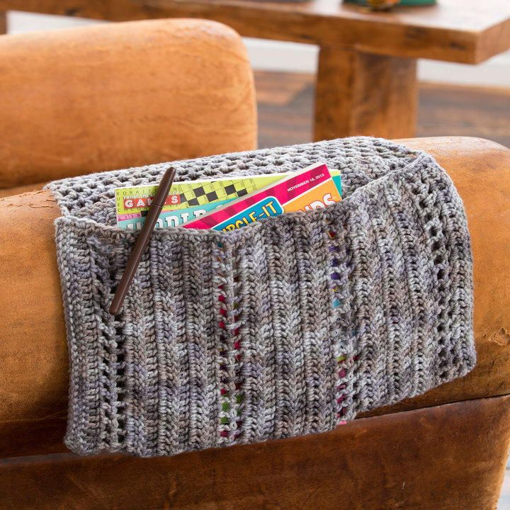 Keep this crocheted pouch handy for holding your remote and other little odds and ends within reach. The Crochet Organizer Caddy slips over the arm of a couch, under the couch cushion or even under the mattress.