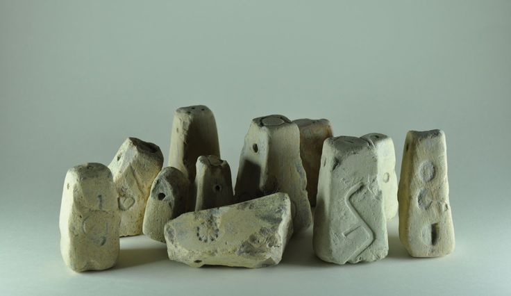 Greek loom weights with marks, 4th century B.C. Greek loom weights with marks. Private collection