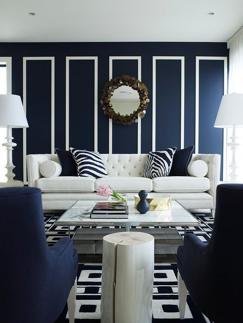 Chic living room and those navy blue walls! Via Huffington Post.