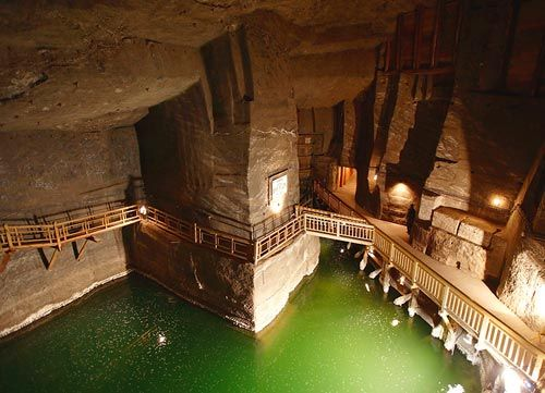 """""""The historic Salt Mine in Wieliczka is the only mining site in the world functioning continuously since the Middle Ages. Its original excavations (longitudinals, traverses, chambers, lakes, as well as minor and major shafts) are located on nine levels and extend for the total of about 300 kilometres: reaching the depth of 327 metres they illustrate all the stages of mining technology development over time."""""""